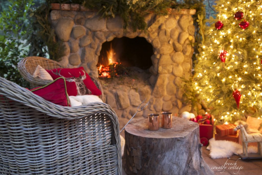 Christmas patio with tree and rock fireplace