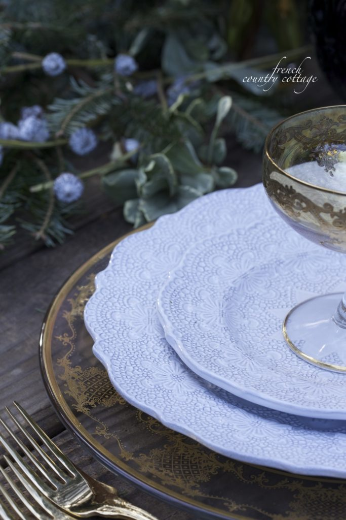 Embossed dishes, gold charger close up table setting