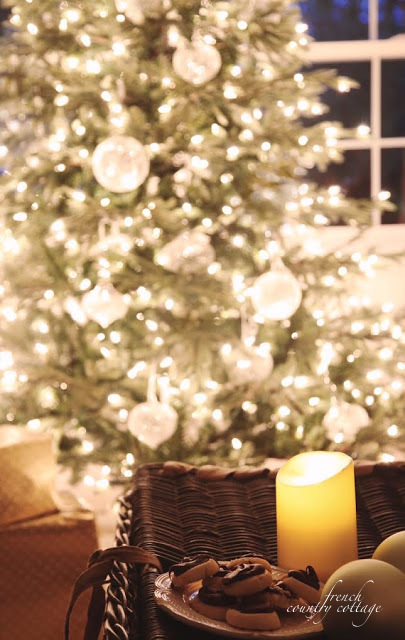 Candle on basket with a Christmas tree