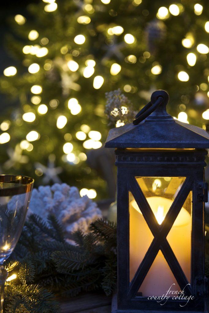 Christmas tree and lantern on table