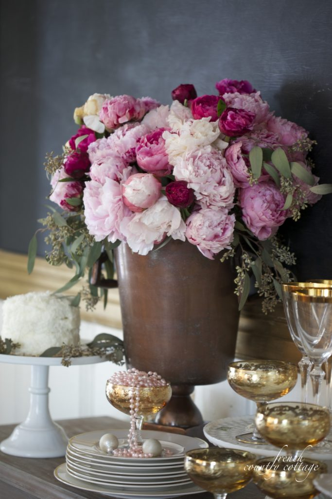 New Years Eve party ideas- gold glasses, cake, peonies