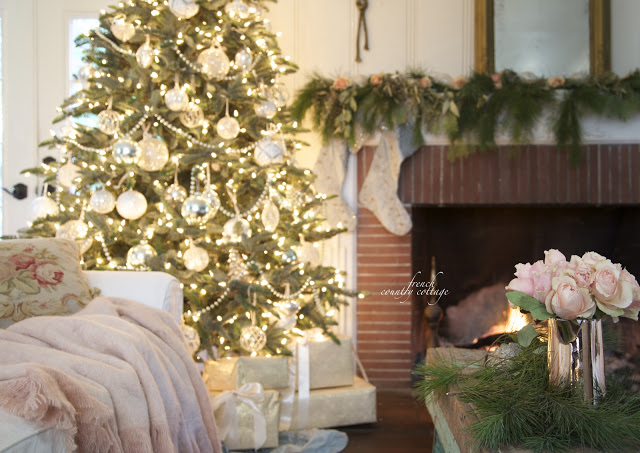French country cottage Christmas living room with tree and fireplace