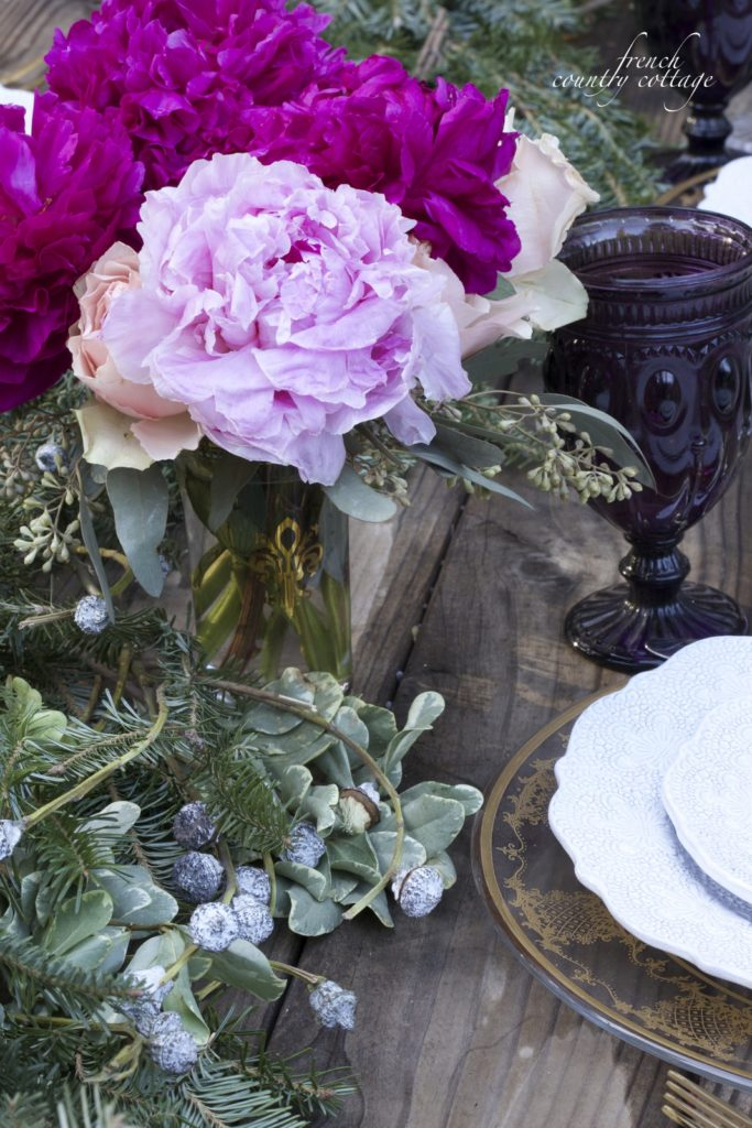 Peonies, eucalyptus pods, Christmas greens elegant table setting