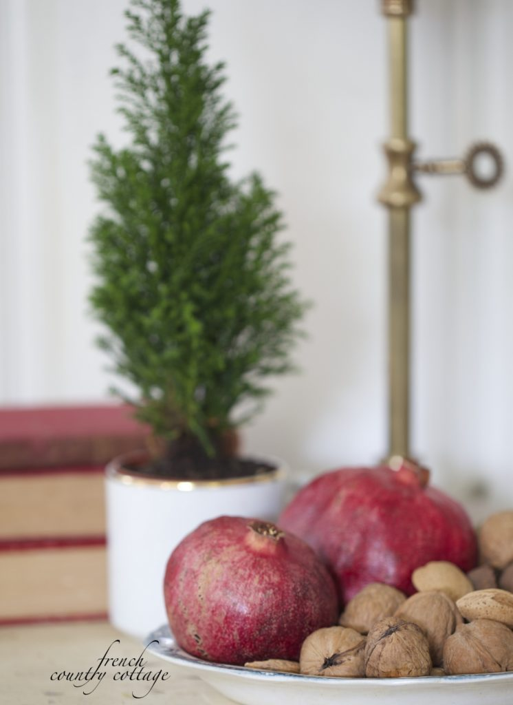 Pomegranates, mixed nuts and Christmas tree