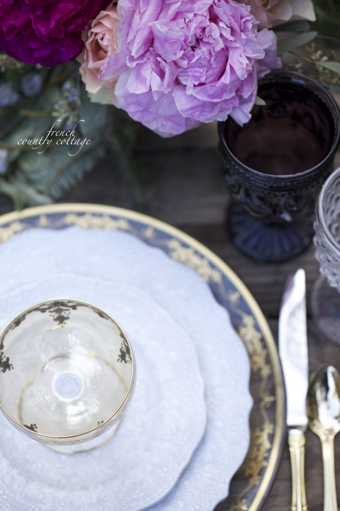 Gold, detailed dishes, purple Christmas table setting