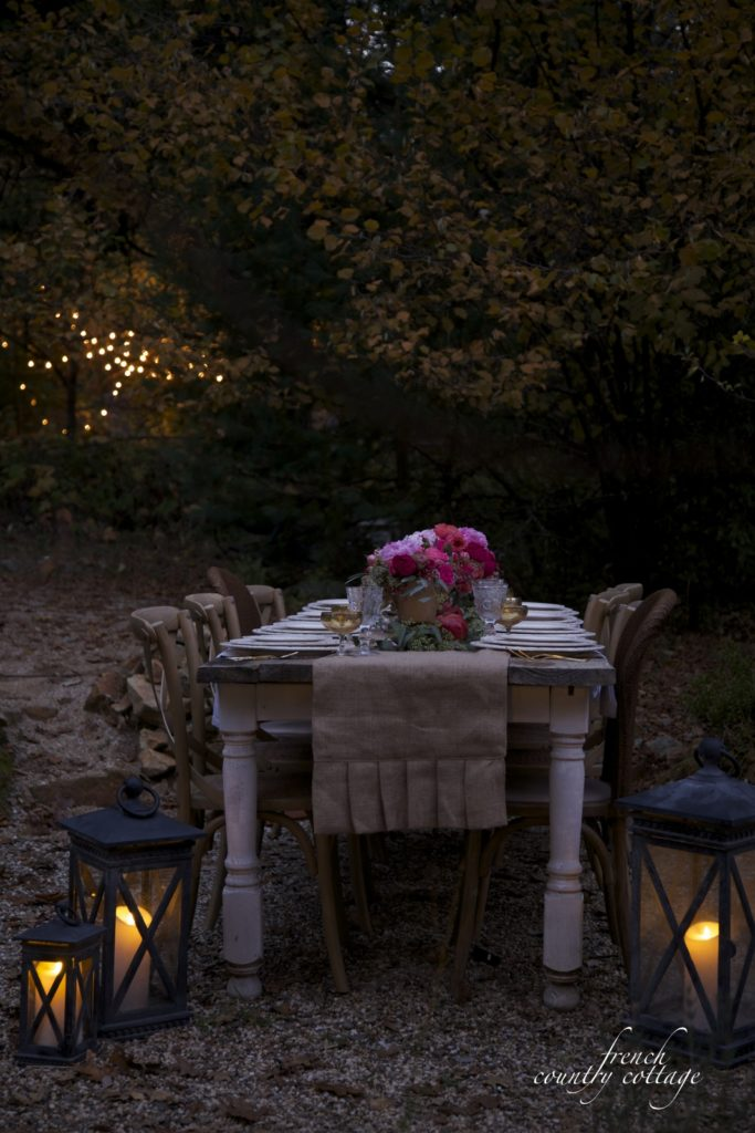 Christmas table setting with lanterns on ground