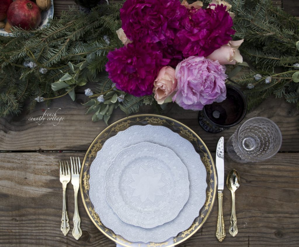 Jewel tones, gold touches and fresh flowers Christmas table setting