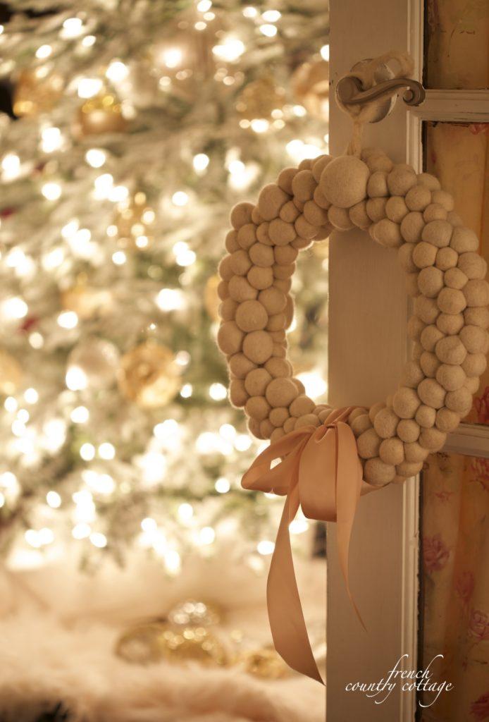 Christmas tree in room, wreath on french door