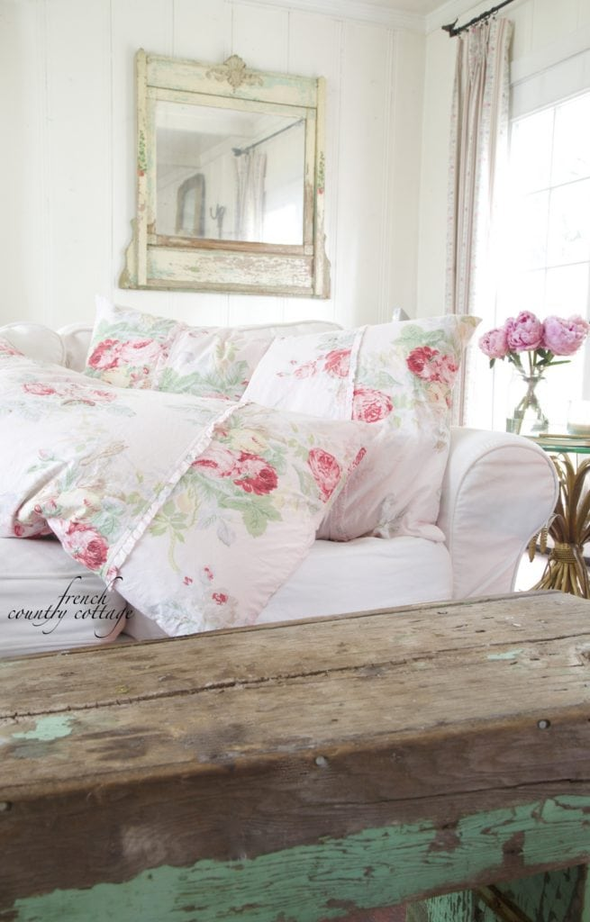 French Cottage linens on sofa with rustic bench
