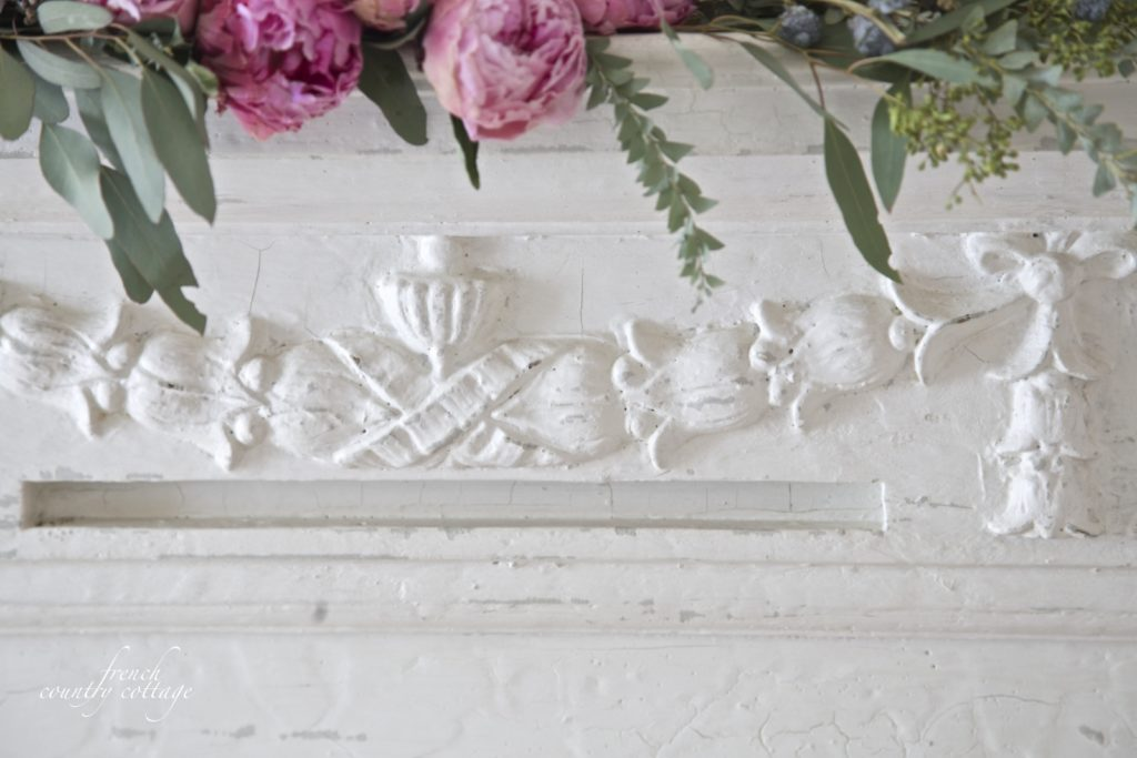 Antique fireplace mantel detail carving