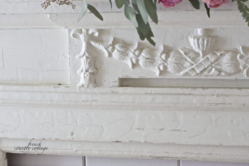 Antique fireplace mantel old paint close up