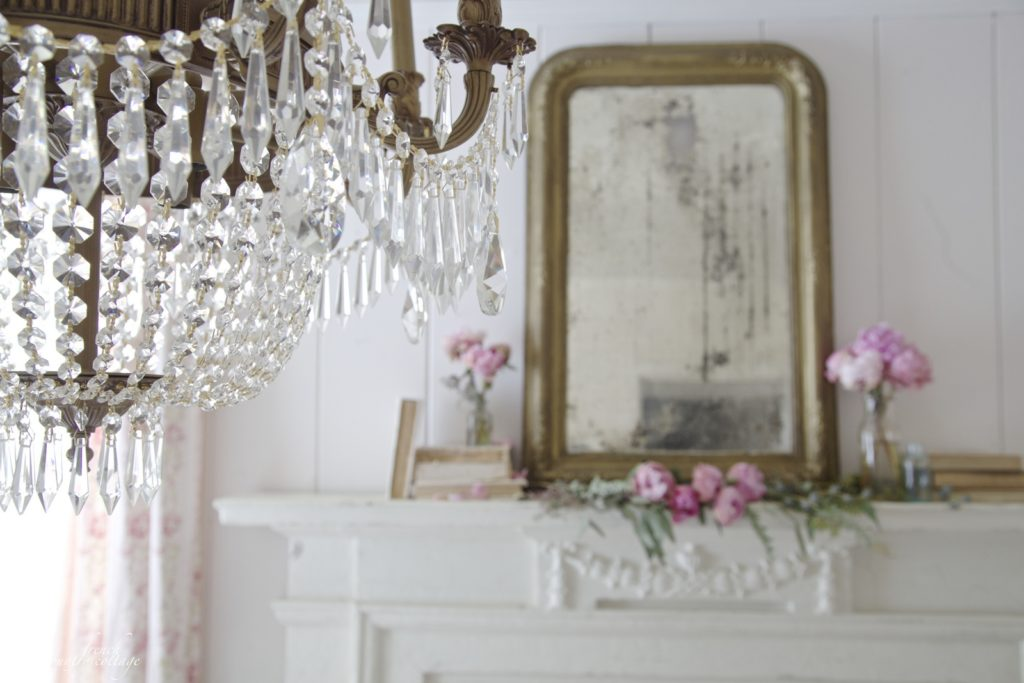 Chandelier, pink peonies and mantel
