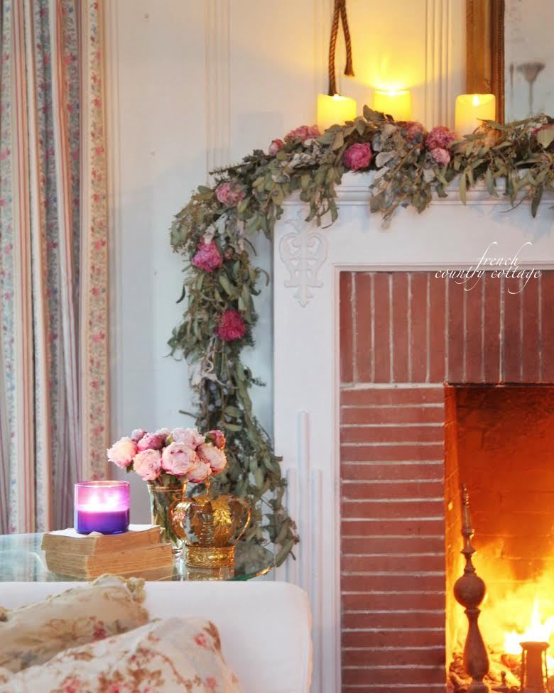 Winter Living Room with fireplace, candles and garland