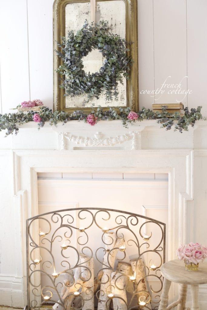 Faux fireplace mantel with eucalyptus and tea light screen