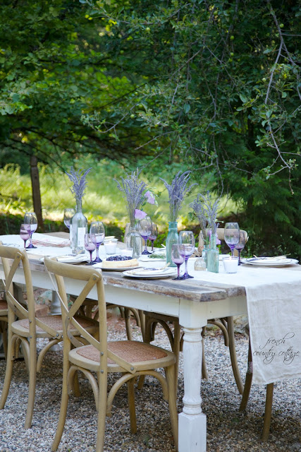 Outdoor table setting purple glasses