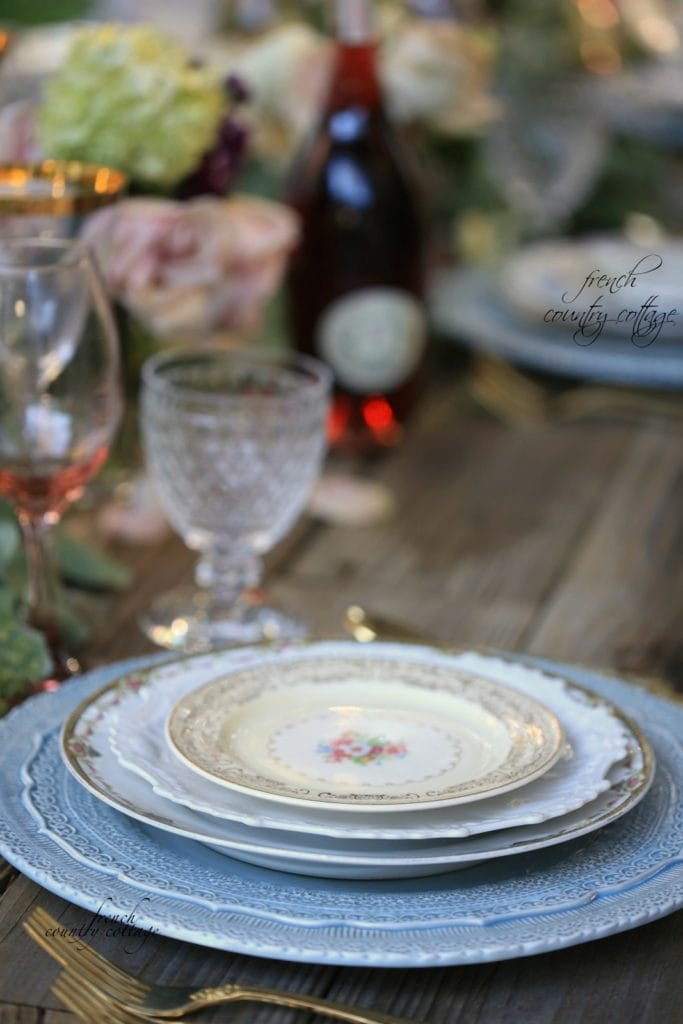 vintage plates stacked on table