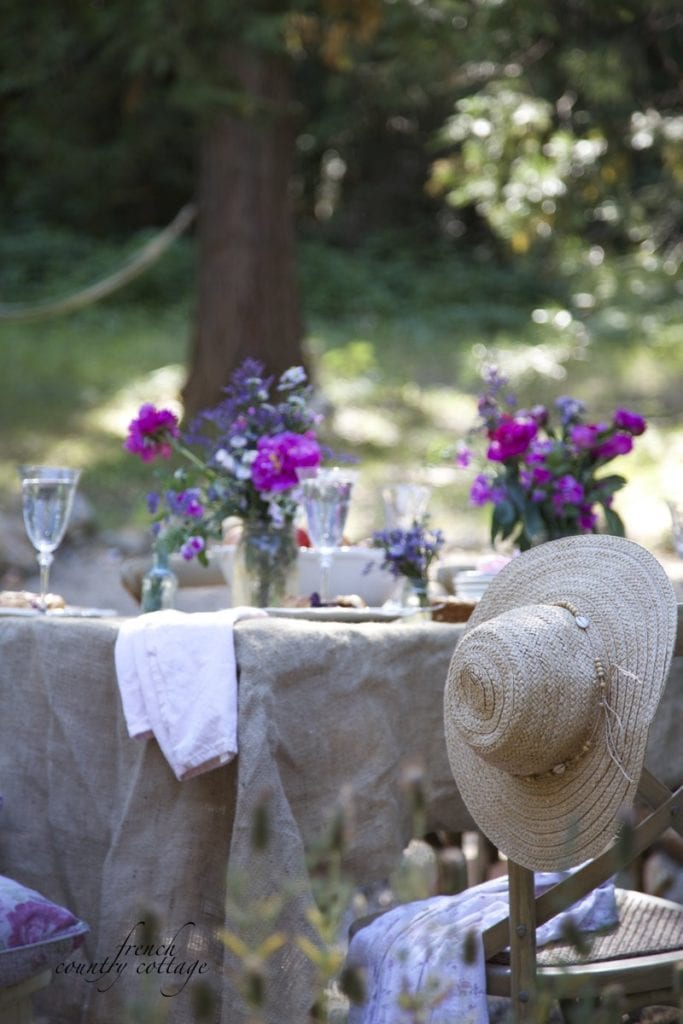 Burlap fabric on table with flowers outdoors