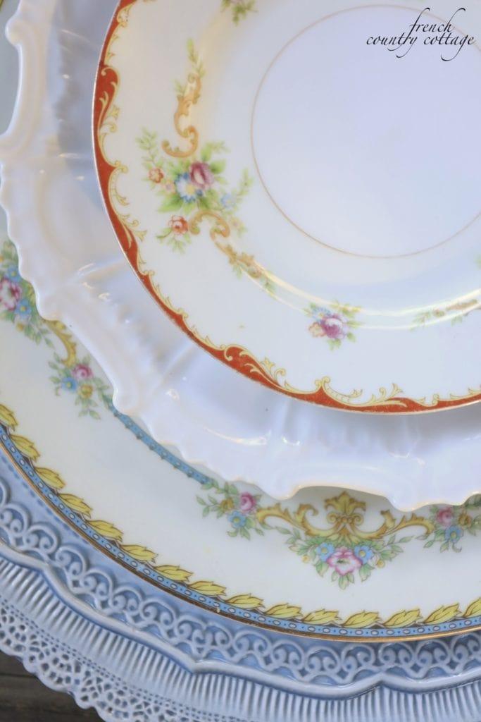 Vintage plates layered on table