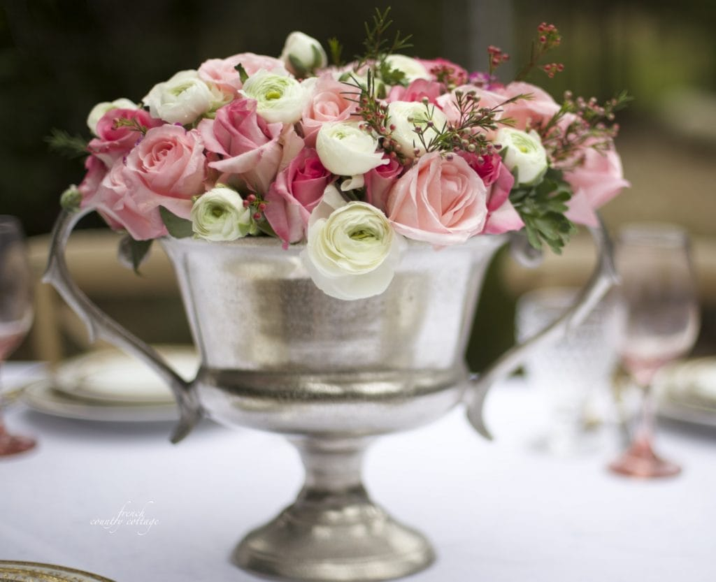 Silver trophy urn filled with flowers for centerpiece