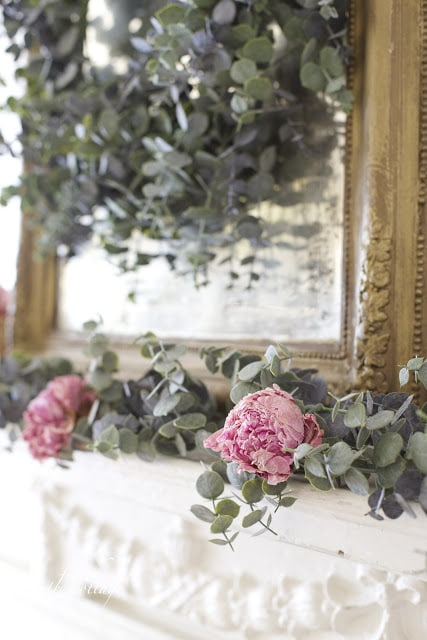 Faux eucalyptus on mantel with dried peonies