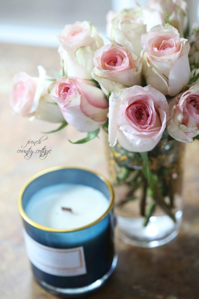 Blush colored roses with blue candle