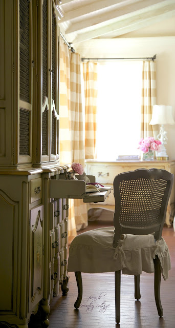 french chair at drop down desk in bedroom