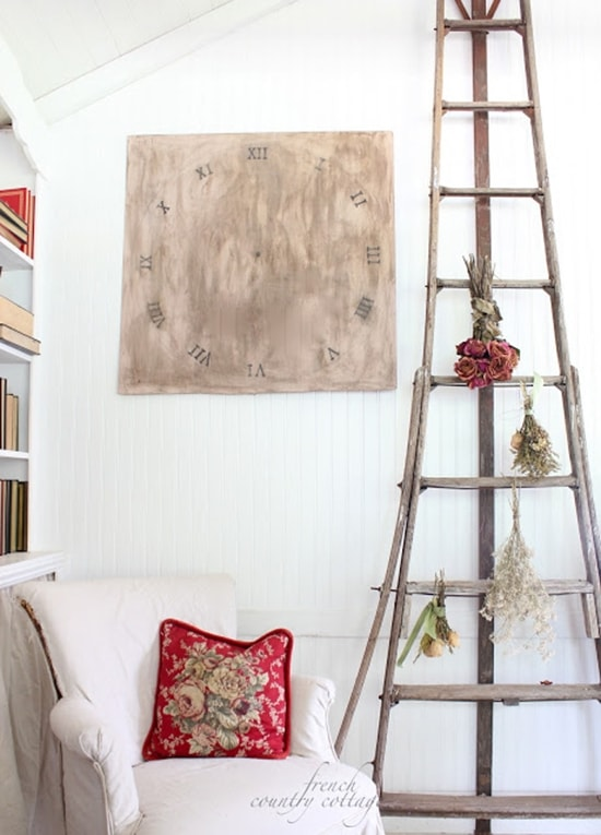 Orchard ladder with wall clock and old chair