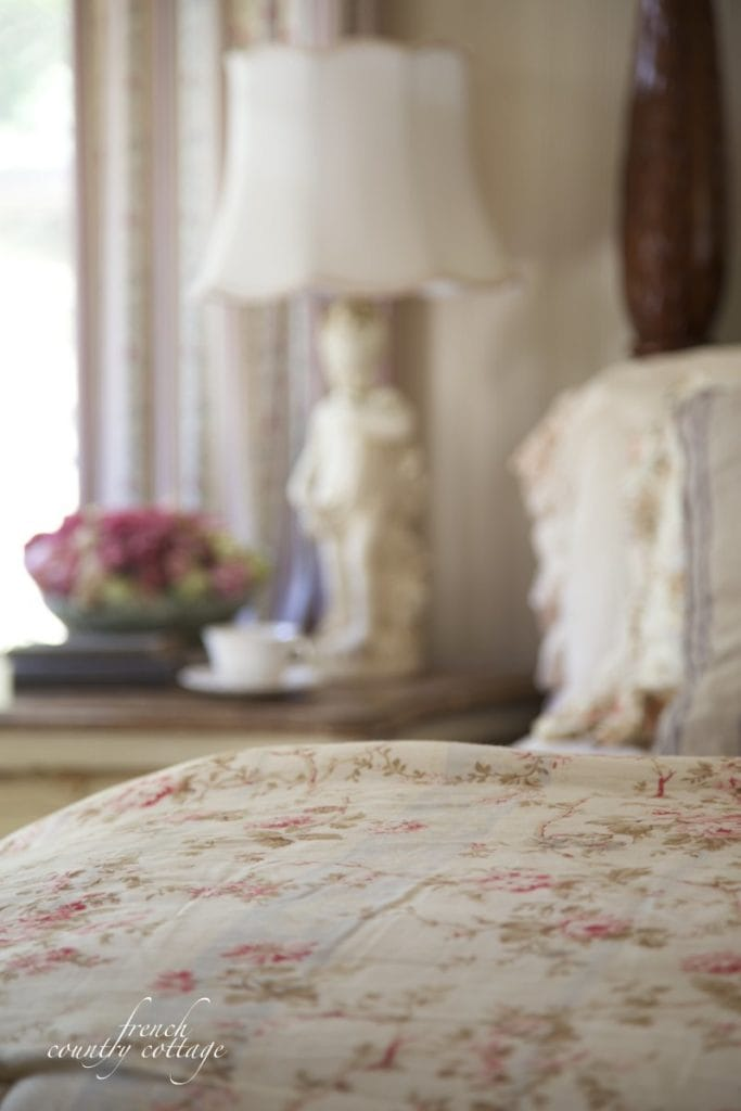 vintage style floral fabric at foot of bed