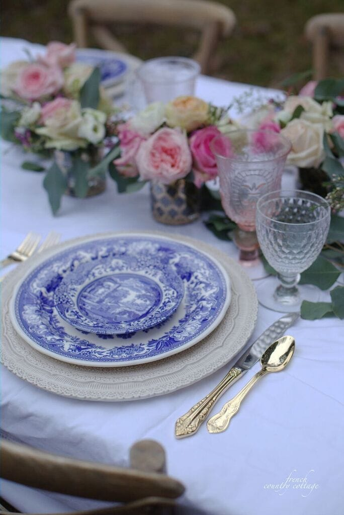 Blue and white dishes with gold flatware