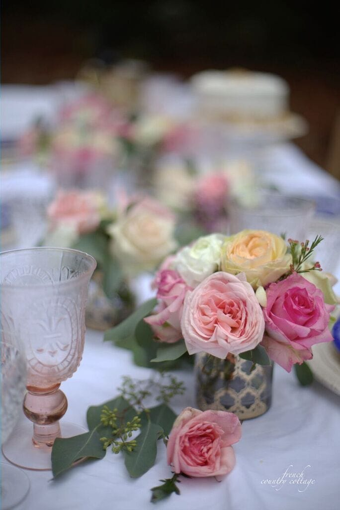 Roses and pink glass on elegant table