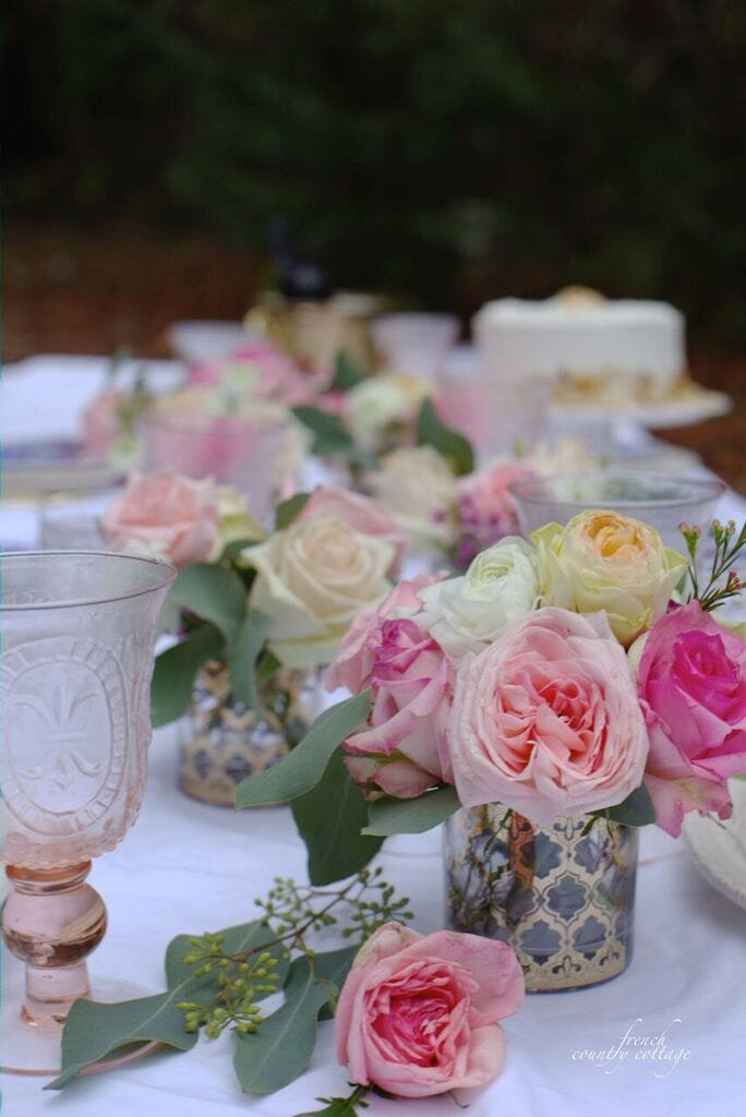 Gold glasses for flower bouquets on table