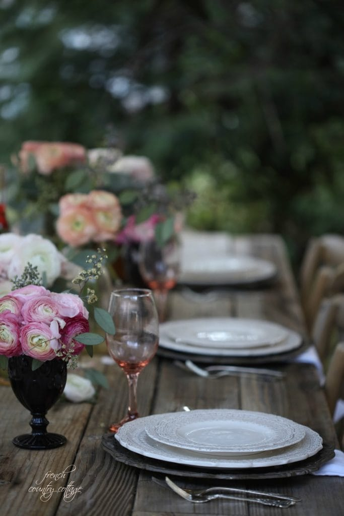 Flowers in goblets as centerpiece on a table