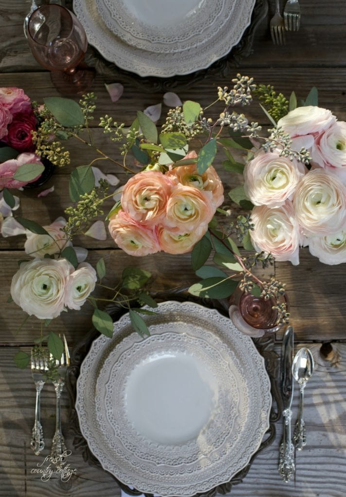 Flowers and dishes on weathered table