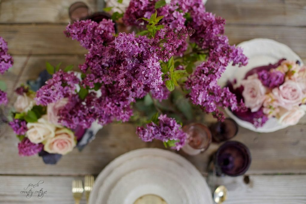Purple flowers on table top
