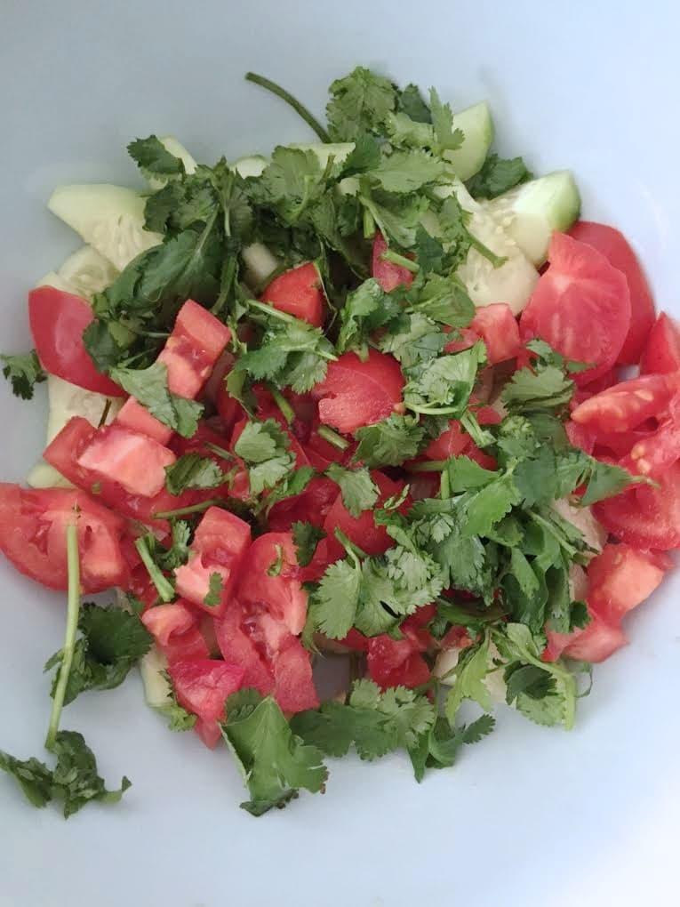 fresh vegetable salad being made in bowl