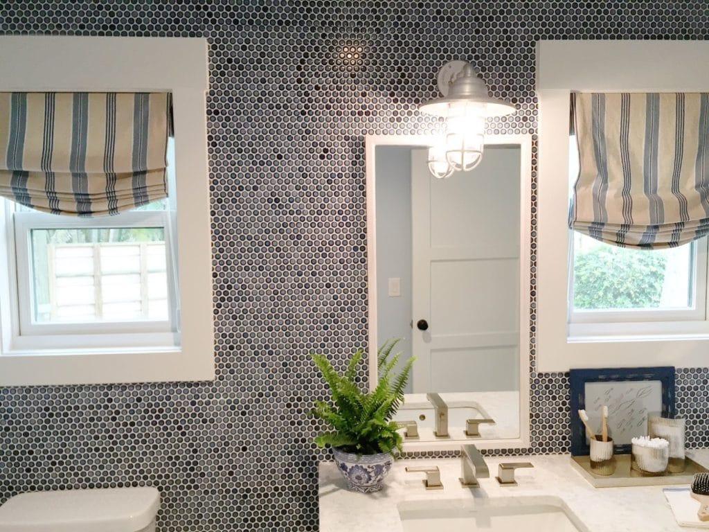 Navy blue penny tile in bathroom