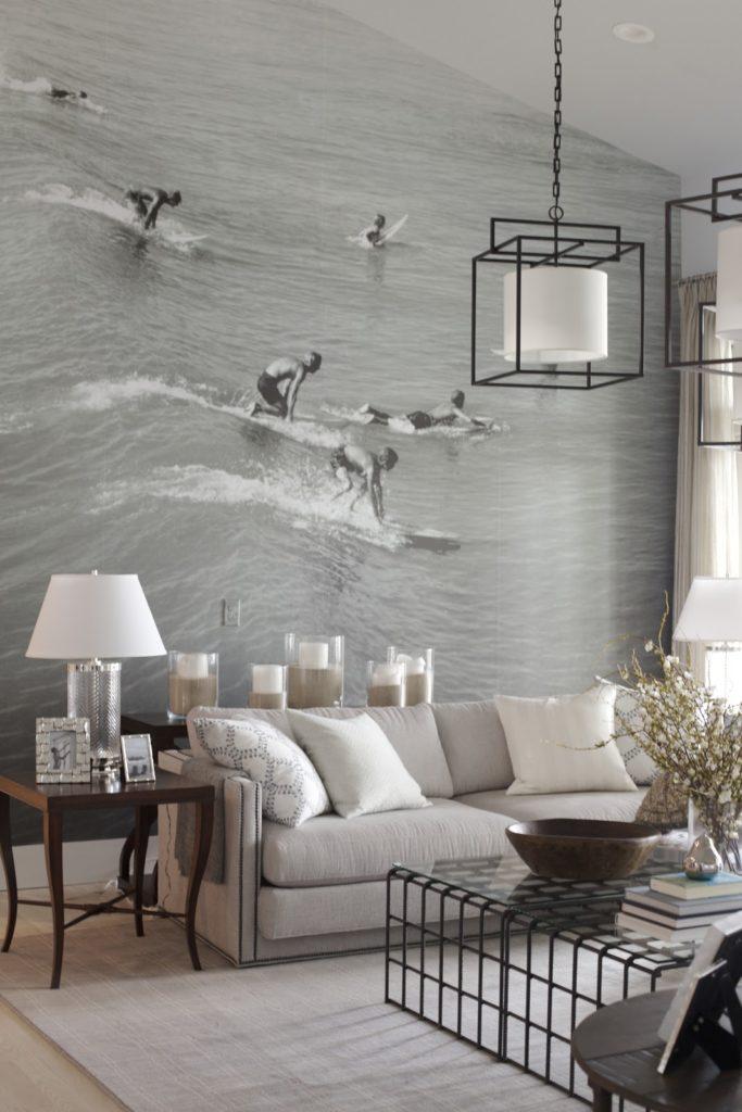 Wall art of surfers in ocean in living room