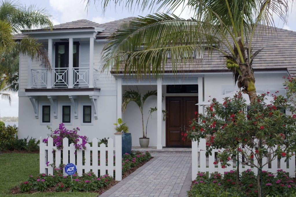 Outside of house with picket fence and flowers
