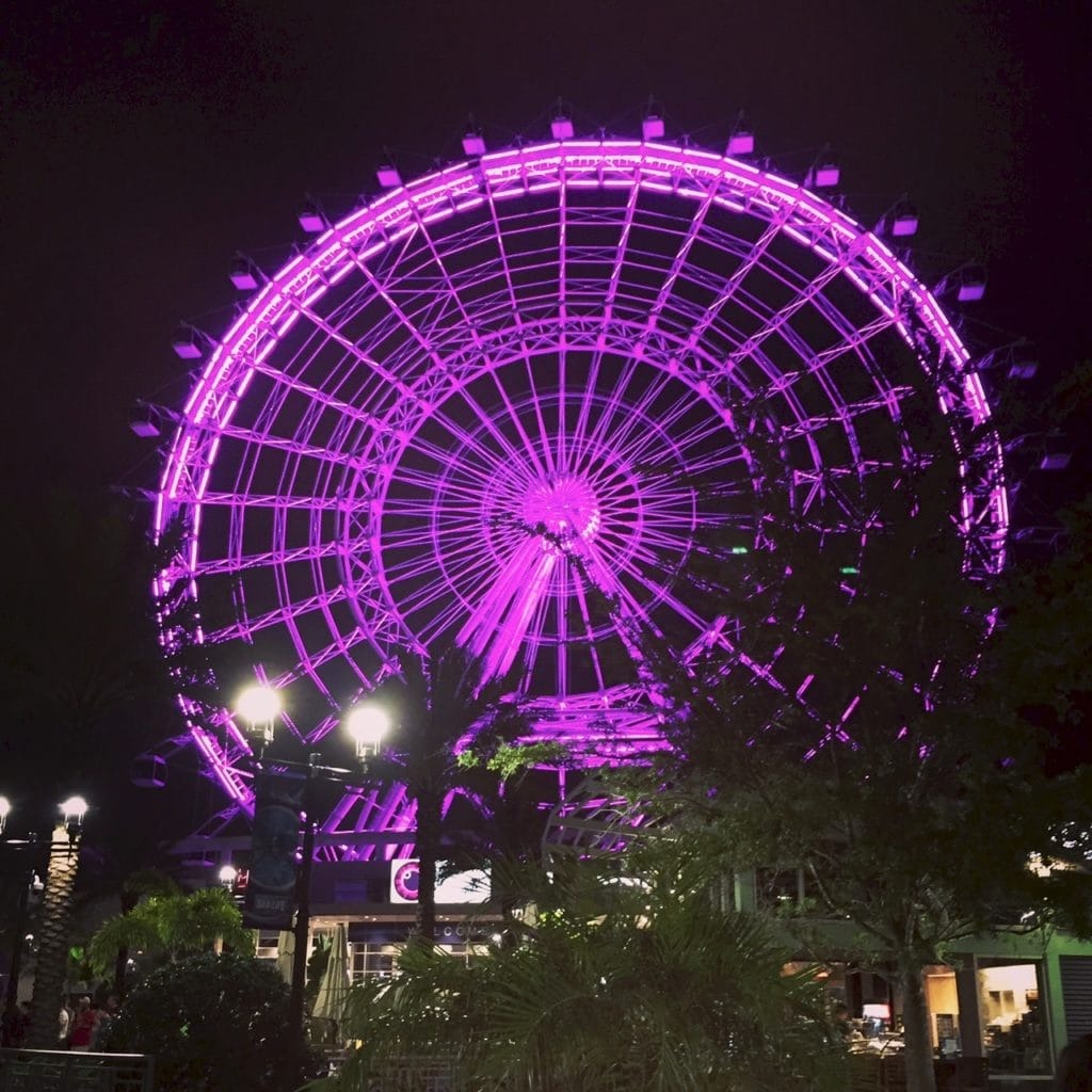 Purple pink on ferris wheel at night
