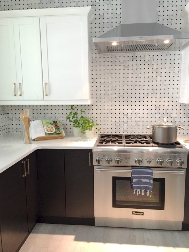 Marble basket weave tile on wall in kitchen