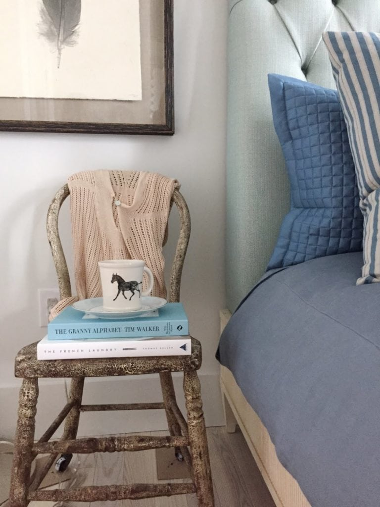 small vintage chair with books
