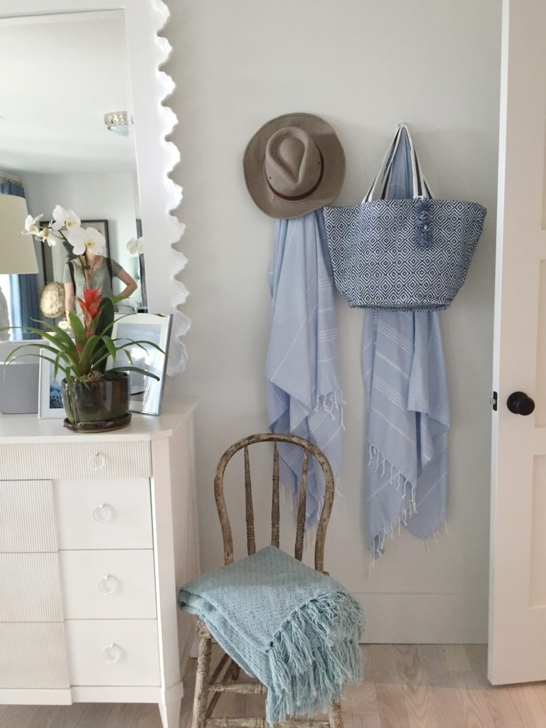 Blue towels and hats on wall