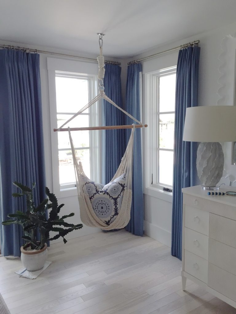 Blue curtains on window