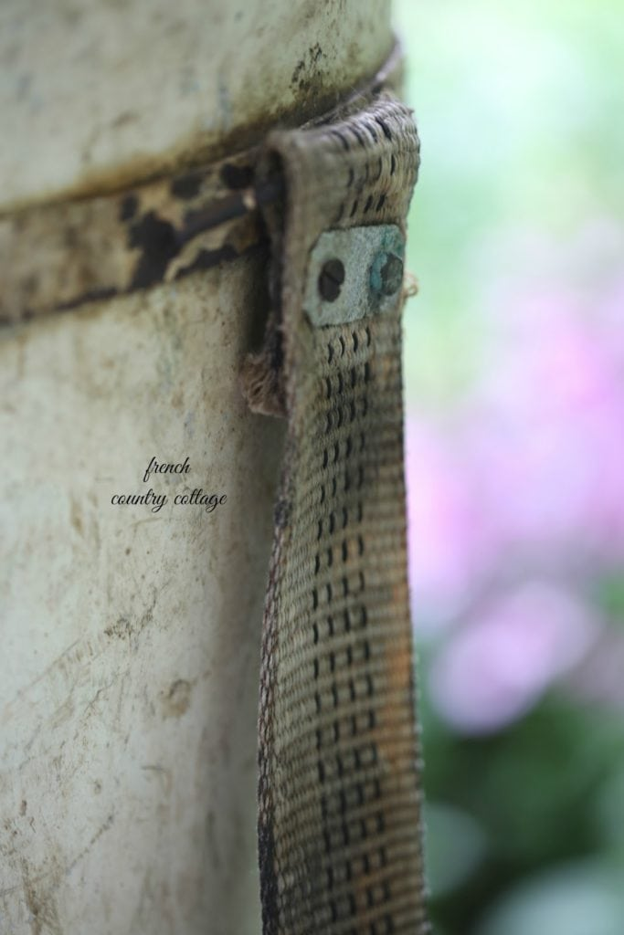 antique bucket with canvas strap close up