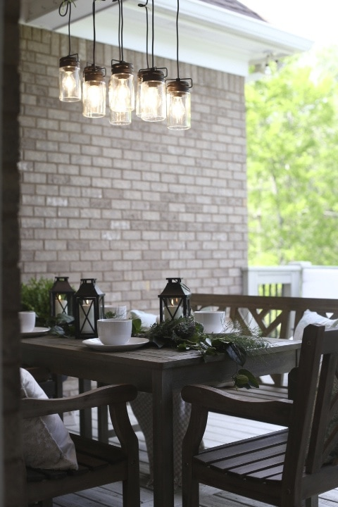 Outdoor dining area with lanterns on table