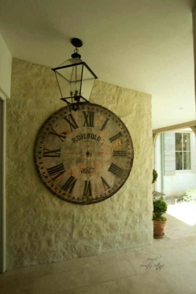 Interior hallway at Patina Farm with oversized clock and lantern light
