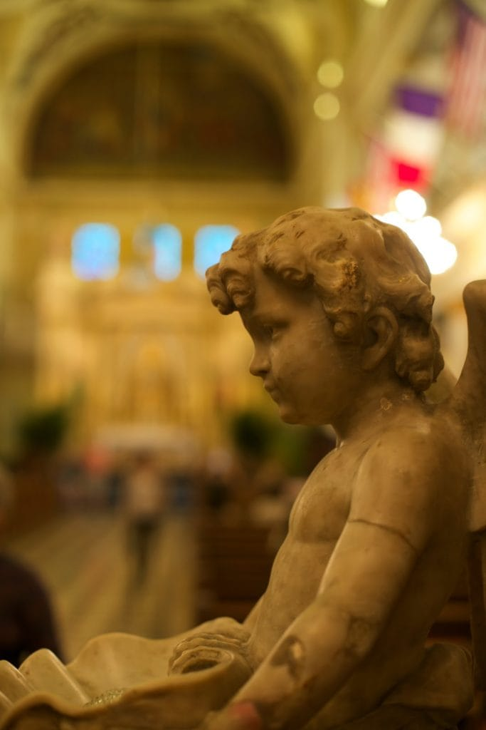 Angel statue inside St. Louis Cathedral in New Orleans