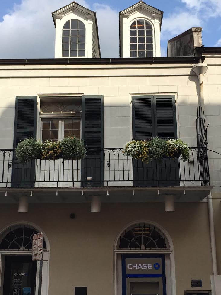 Shutters and arched windows on building in New Orleans