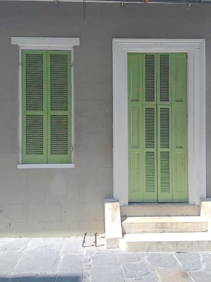 Shutter doors in pea green in New Orleans