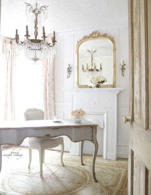 french style office with blush walls and gray desk with gold